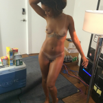 8. Second Full shot of Naked Rihanna from the front in the change room with Grand Theft Auto in the background