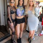 Kylie and Kendall together in ripped clothes. Hat!